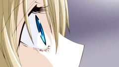 Handsome blonde teen with big blue eyes in anime toon